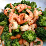 Healthy Recipes For Rapid Weight Loss - Shrimp, sliced almonds, broccoli, cauliflower & summer squash on spinach image